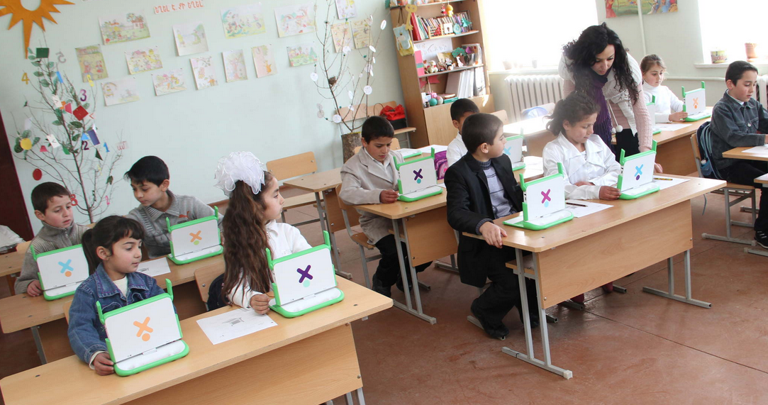 "Children using laptops provided by ""One Laptop Per Child"